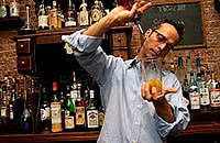 Bartender pouring drinks at bar